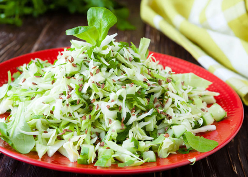 Salad with young cabbage with cucumbers and greens recipe